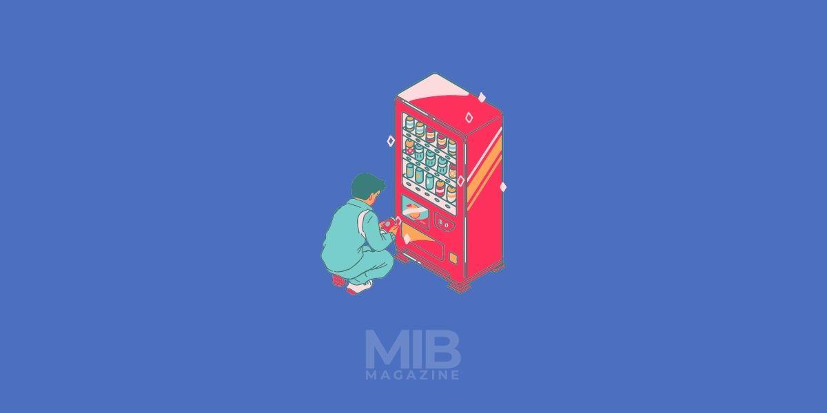 a man operating vending machine